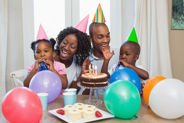 bigstock-Happy-family-celebrating-a-bir-69733369