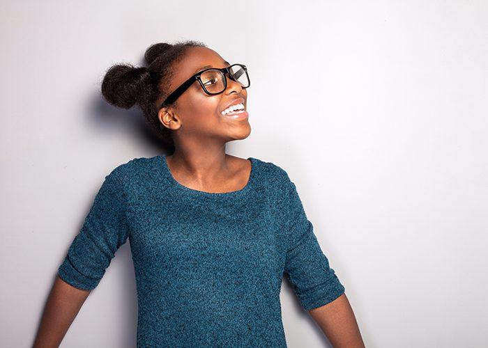 bigstock-Happy-Young-Girl-In-Eyeglasses-103037093