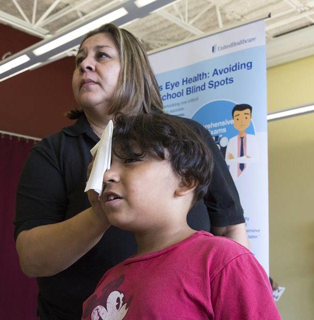 Prevent Blindness Texas employee administering screening